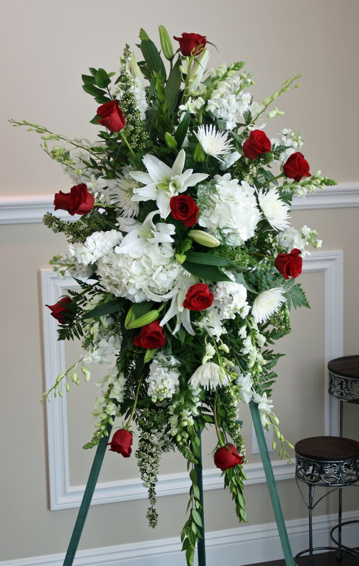 Casket spray of red and white roses along with calla ...  |Casket Flowers